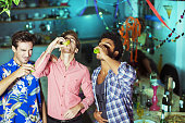 Men taking shots at party