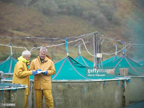 Men taking stock on Scottish salmon hatchery