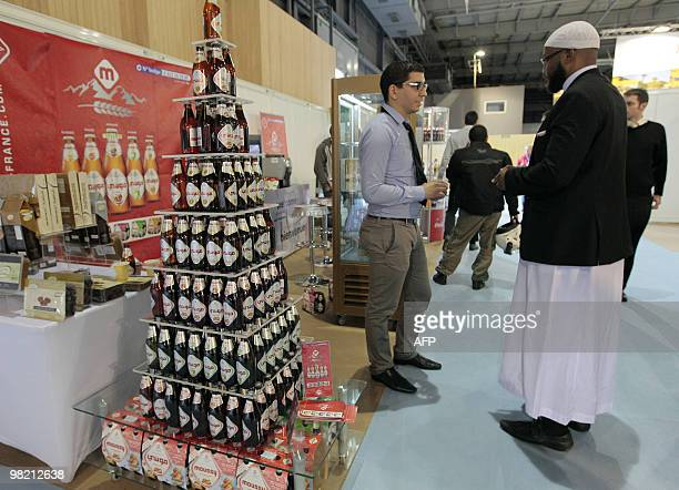 Men talk at a stand of Halal products on March 31 2010 during the Halal expo part of the 'Foodsgoods' fair at the Porte de Versailles exhibition...