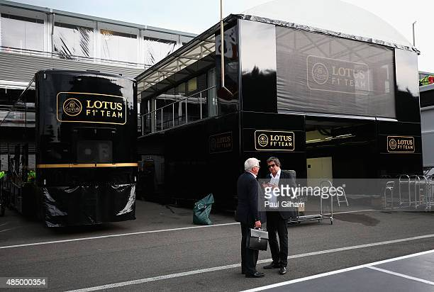 Men talk outside the Lotus garage as the team pack down at the end of the Formula One Grand Prix of Belgium at Circuit de SpaFrancorchamps on August...