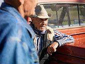 Men Talking Beside an Old Pickup Truck