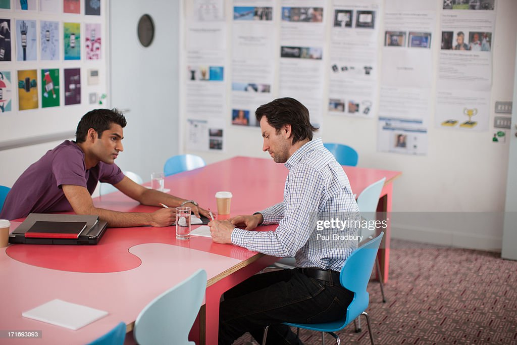 Men talking in meeting : Stock Photo