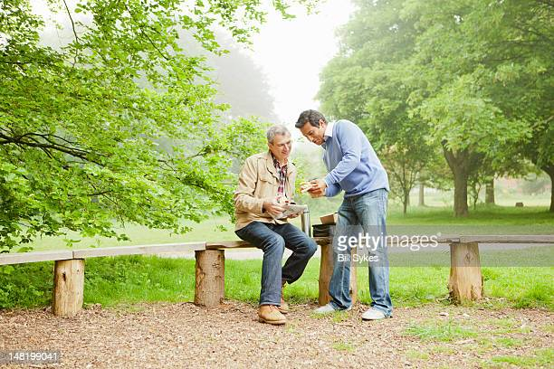 Men talking in park