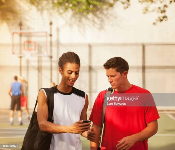 Men talking on basketball court