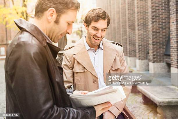 Men talking on city street