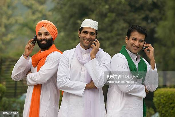 Men talking on mobile phones