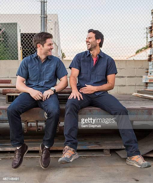 Men talking outdoors