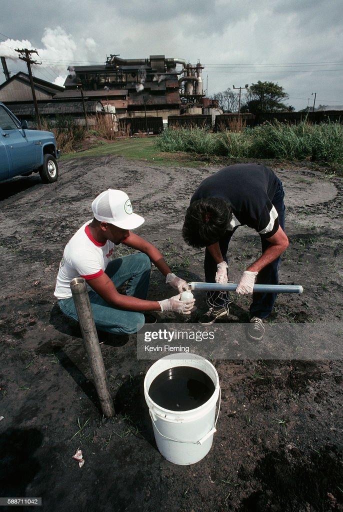 Men Testing Groundwater Near a Sugar Mill