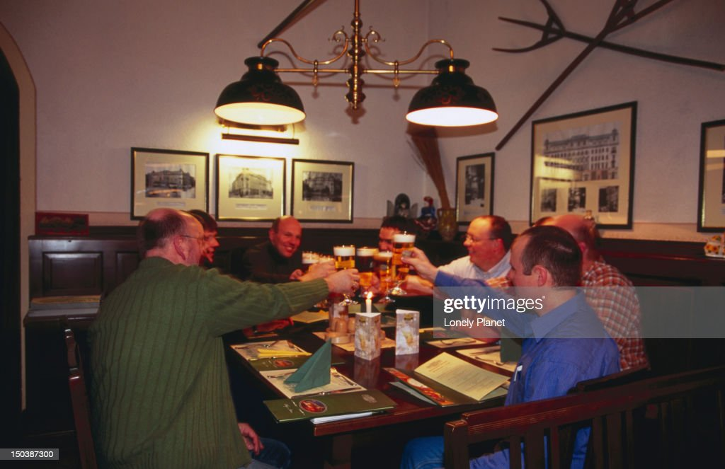 Men toasting in beerhall at Gerbeaud. : Stock Photo
