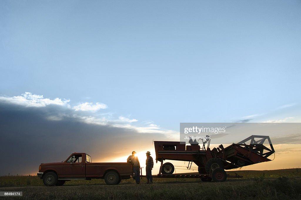 Men towing tractor