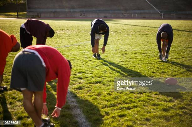Men training on football field