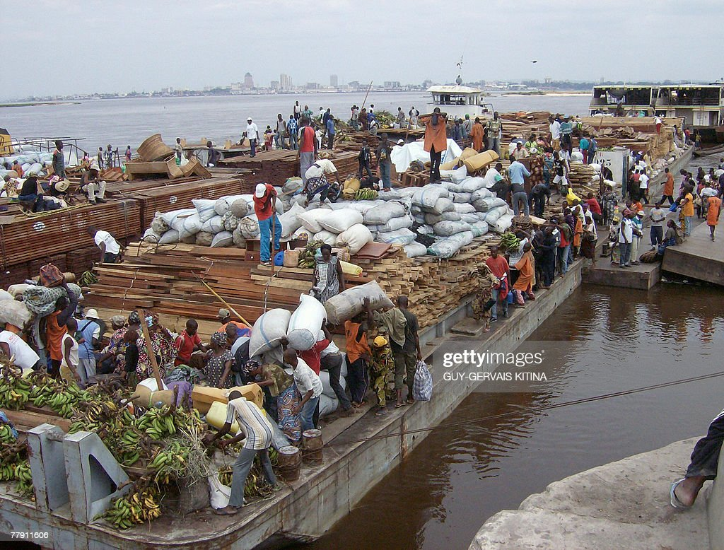 Men unload goods at the arrival of a ship in the harbor of Brazzaville 14 November 2007 Due to the lack of passenger ships northern Congolese relay...
