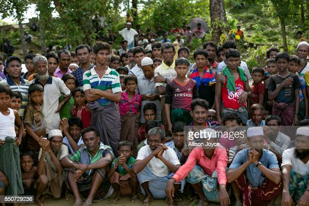 COX'S BAZAR BANGLADESH SEPTEMBER 21 Men wait for aid in the Balukhali Rohingya refugee camp on September 21 2017 in Cox's Bazar Bangladesh Over...