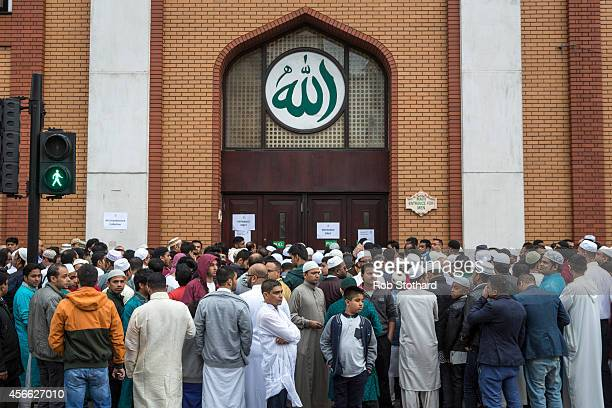 Men wait to enter the East London Mosque to perform the Eid AlAdha prayers on October 4 2014 in London England Muslims around the world are...