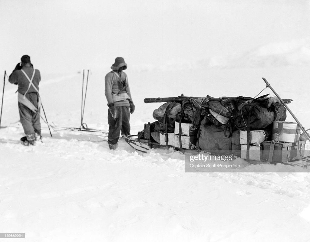 Men waiting to depart on Beardmore Glacier photographed during the last, tragic voyage to Antarctica by Captain Robert Falcon Scott on 13th December 1911. Scott was tutored by Herbert Ponting, the renowned photographer who was the camera artist to the expedition, which enabled Scott to take his own memorable pictures before perishing on his return from the South Pole on or after 29th March 1912.