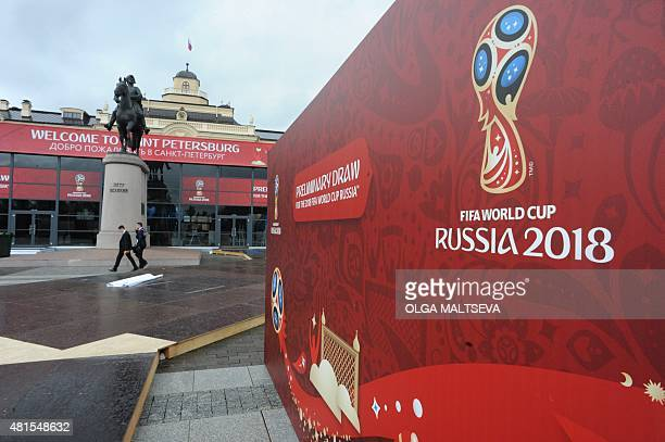 Men walk along a hall close to the Constantine Palace in St Petersburg on July 22 where the Preliminary draw for the 2018 FIFA World Cup will be held...