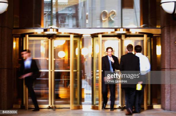 Men walk in and out of the Goldman Sachs headquarters building December 16 2008 in New York The storied financial firm on December 16 posted its...