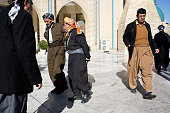 Men walk in and out of the Grand Mosque in Sulaimaniyah