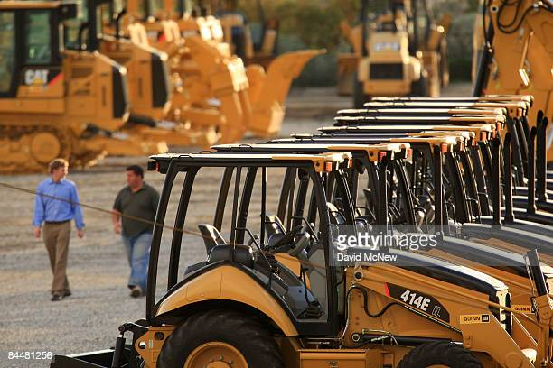 Men walk near rows of Caterpillar products at Quinn Co Caterpillar on January 26 2009 in City of Industry California Under presser of a worsening...