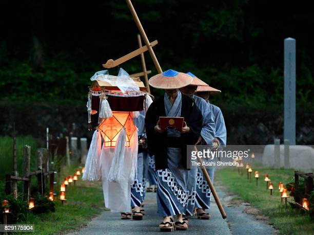 Men walk with repeating Buddhist chant during the 'Yonenbutsu and Bon Odori' Dance at Heishoji Temple on August 10 2017 in Toyota Aichi Japan The...