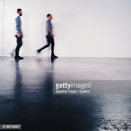 Men Walking In Street