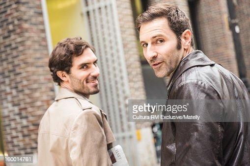 Men walking on city street
