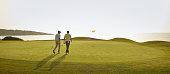 Men walking on golf course