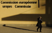 A men walks in front of the European Union Commission building at the EU Headquarters in Brussels on March 5 2013 AFP PHOTO / JOHN THYS