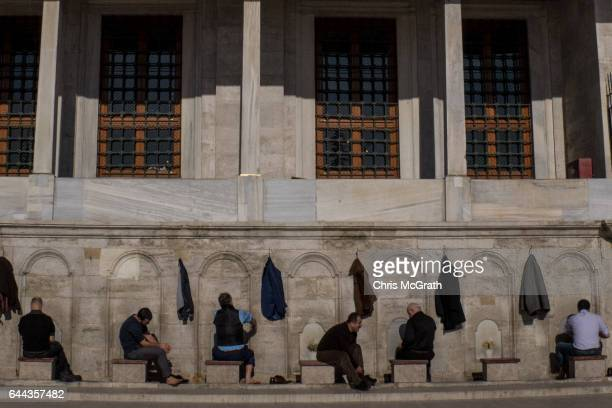 Men wash ahead of prayer outside the Fatih Mosque on February 23 2017 in Istanbul Turkey Turkey will hold its constitutional referendum on April 16...