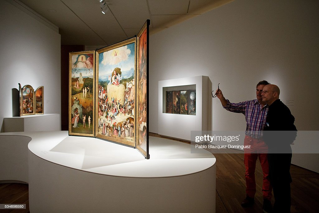 Men watch 'The Haywain Triptych' from Dutch painter Hieronymus Bosch during a press preview at El Prado Museum on May 27, 2016 in Madrid, Spain. The Prado Museum holds the 'El Bosco' (Hieronymus Bosch) painter major exhibition to celebrate the fifth century anniversary of the Dutch artist's death (ca. 1450-1516) featuring sixty five works from various Spanish and global museums.
