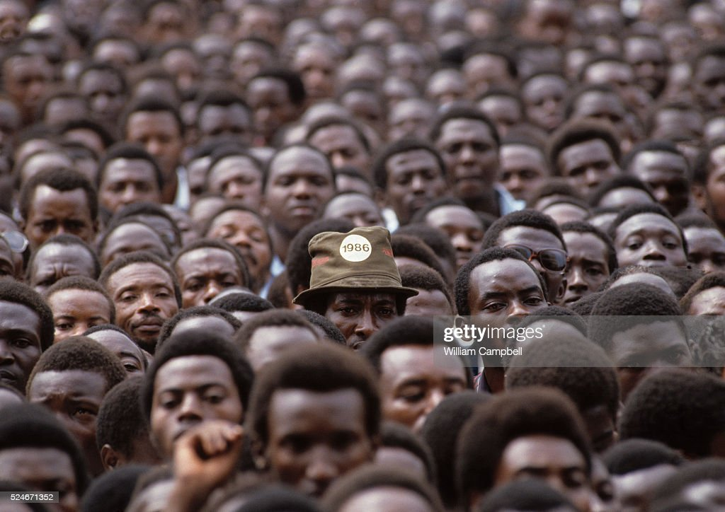 Men watch the inauguration of Yoweri Museveni National Resistance Army leader who overthrew Ugandan President Milton Obote and became military ruler...