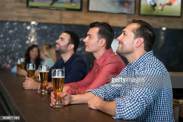 Men watching football at a sports bar