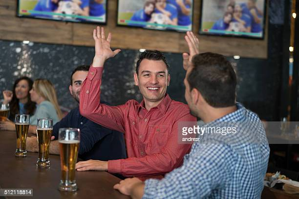 Men watching sports at the pub