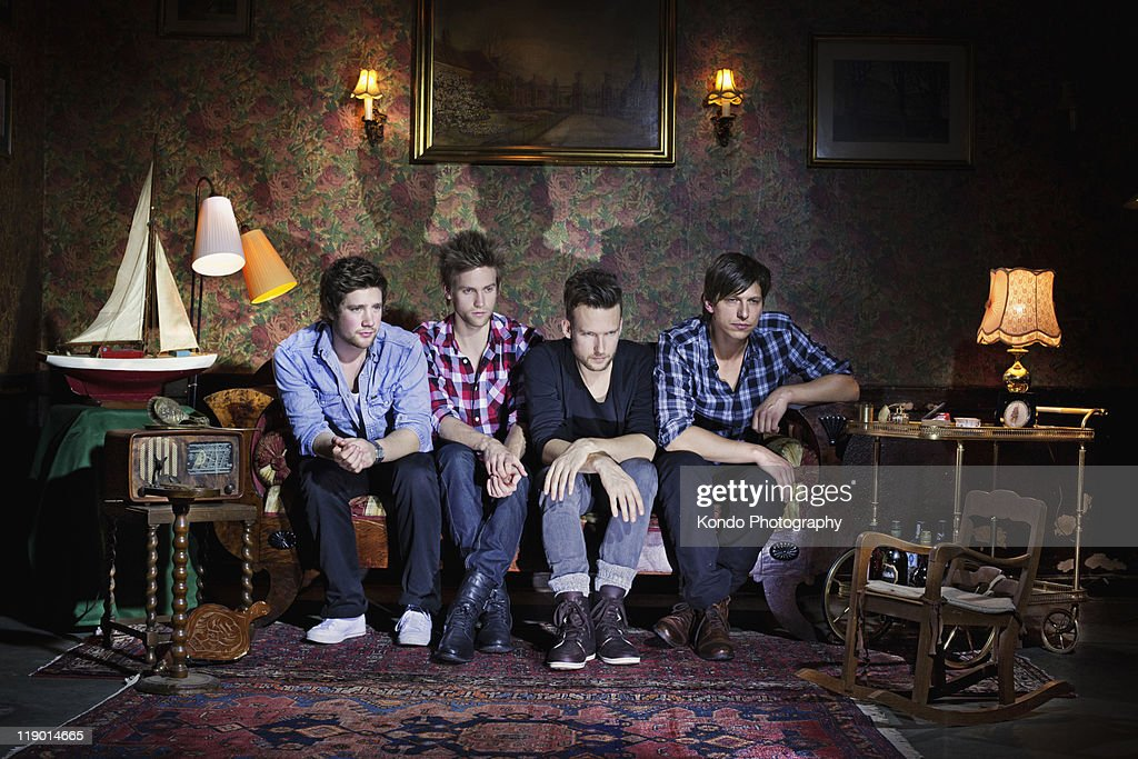 Men watching television in living room : Stock Photo