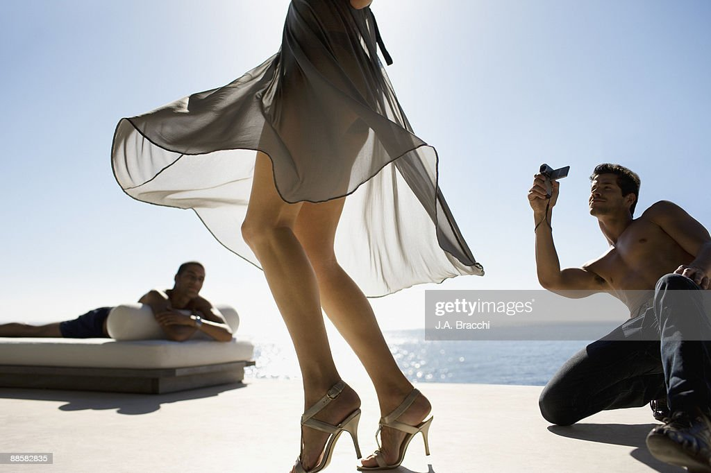 Men watching woman walking in high heels : Stock Photo