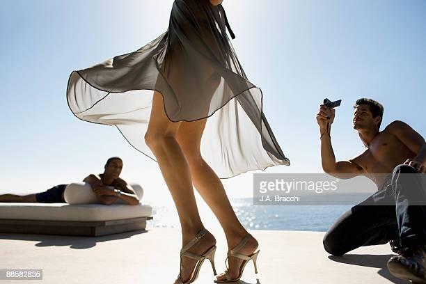 Men watching woman walking in high heels