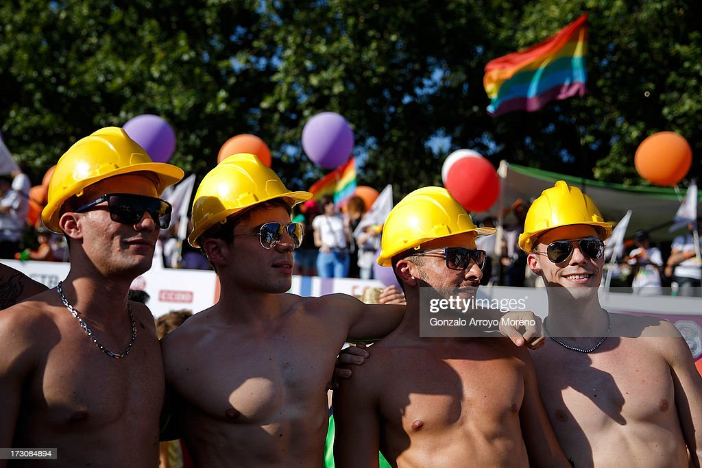 Men wear hard hats during the Madrid Gay Pride Parade 2013 on July 6, 2013 in Madrid, Spain. According to a new Pew Research Center survey about homosexual acceptance around the world, Spain tops gay-friendly countries with an 88 percent acceptance rate.