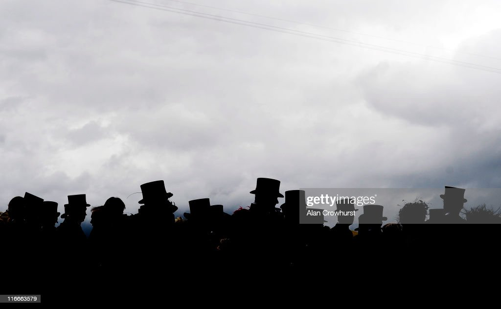 Men wear top hats during day four of Royal Ascot at Ascot racecourse on June 17, 2011 in Ascot, England.