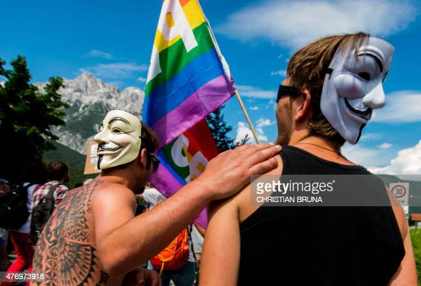 Men wearing a Guy Fawkes masks take part in a demonstration against the Bilderberg conference in Telfs Austria on June 13 2015 The Bilderberg group...