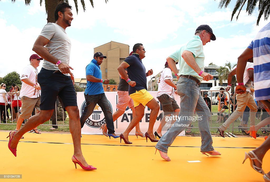 Men wearing high heeled shoes take part in a Guinness World Record attempt for the largest amount of people running in high heels on February 14, 2016 in Melbourne, Australia. The World's Largest High Heel Race 2016 raised funds for the The Warwick Cancer Foundation. The current record is 967 people, completed in Indiana, USA in 2010.