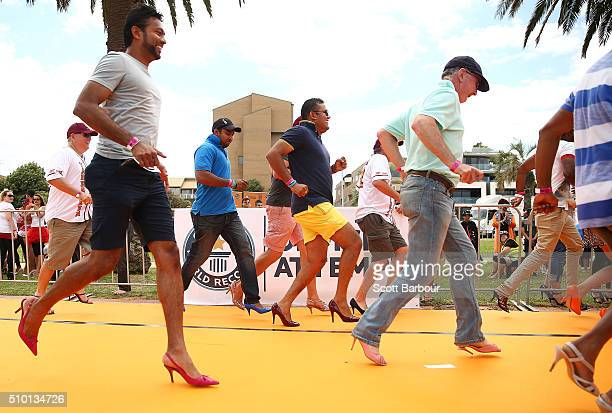 Men wearing high heeled shoes take part in a Guinness World Record attempt for the largest amount of people running in high heels on February 14 2016...