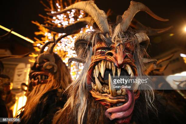 Men wearing horned wooden masks and dressed as the Krampus creature prepare to participate in the annual Krampus parade on Saint Nicholas Day on...