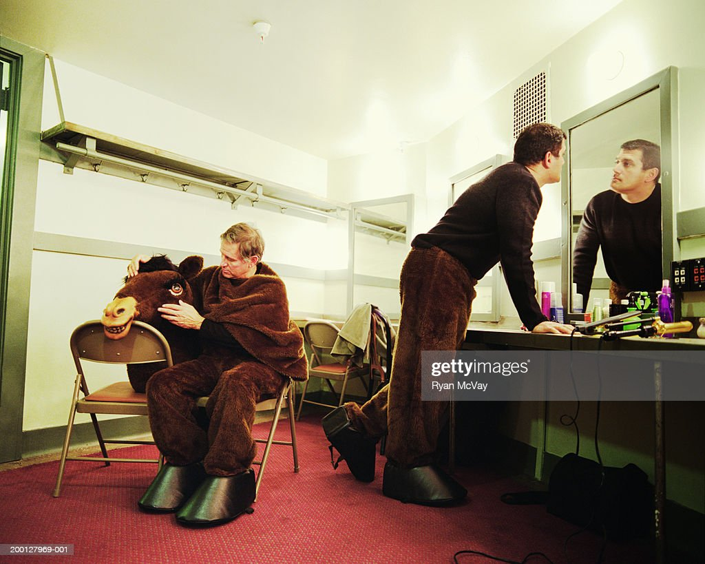 Men wearing horse costume, waiting in dressing room : Stock Photo