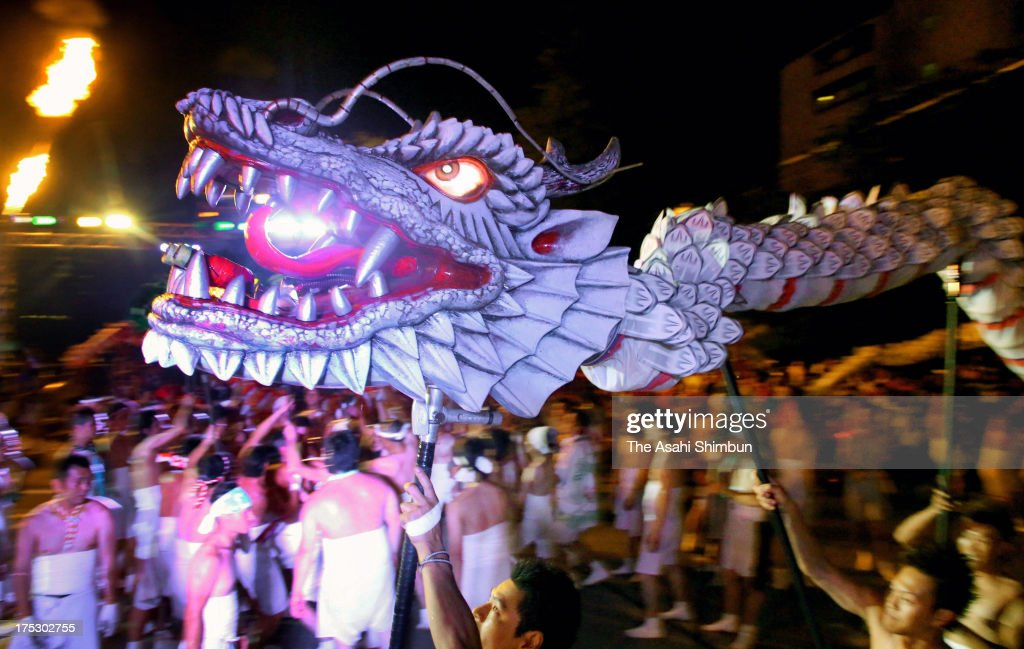 Men wearing loincloths perform dragon dance during the Ryujin Fire Festival at Gero Hot Spring on August 1, 2013 in Gero, Gifu, Japan. The dance performance is a part of the Gero Onsen Festival, held until August 4.