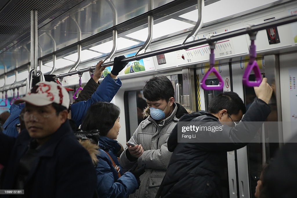 A men wearing the mask takes the subway during severe pollution on January 23, 2013 in Beijing, China. The air quality in Beijing on Wednesday hit serious levels again, as smog blanketed the city.
