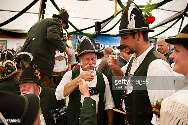 Men wearing traditional Bavarian attire in a beer tent at the Oktoberfest on September 17 2010 in Munich Germany