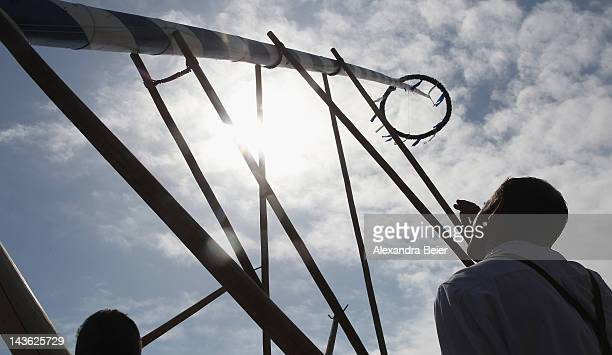 Men wearing traditional Bavarian dress take part in the Bavarian tradition of raising the maypole as part of May Day celebrations on May 1 2012 in...