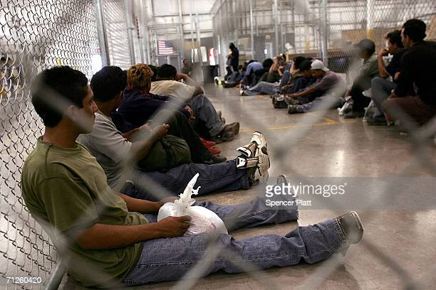 Men who were caught crossing the US border with Mexico illegally wait in a holding cell on June 21 2006 at the US Border Patrol processing center in...