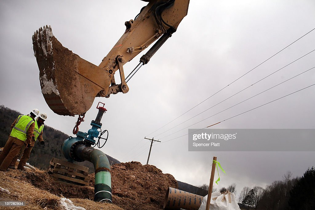 Men with Cabot Oil and Gas work on a natural gas valve at a hydraulic fracturing site on January 18, 2012 in South Montrose, Pennsylvania. Hydraulic fracturing, also known as fracking, stimulates gas production by injecting wells with high volumes of chemical-laced water in order to free-up pockets of natural gas below. The process is controversial with critics saying it could poison water supplies, while the natural-gas industry says it's been used safely for decades. While New York State has yet to decide whether to allow fracking, economically struggling Binghamton has passed a drilling ban which prohibits any exploration or extraction of natural gas in the city for the next two years. The Marcellus Shale Gas Feld extends through parts of New York State, Pennsylvania, Ohio and West Virginia and could hold up to 500 trillion cubic feet of natural gas.