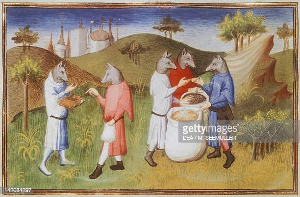 Men with heads like dogs on Andaman Island in the Gulf of Bengal miniature fromLivre des merveilles du monde by Marco Polo and Rustichello France...